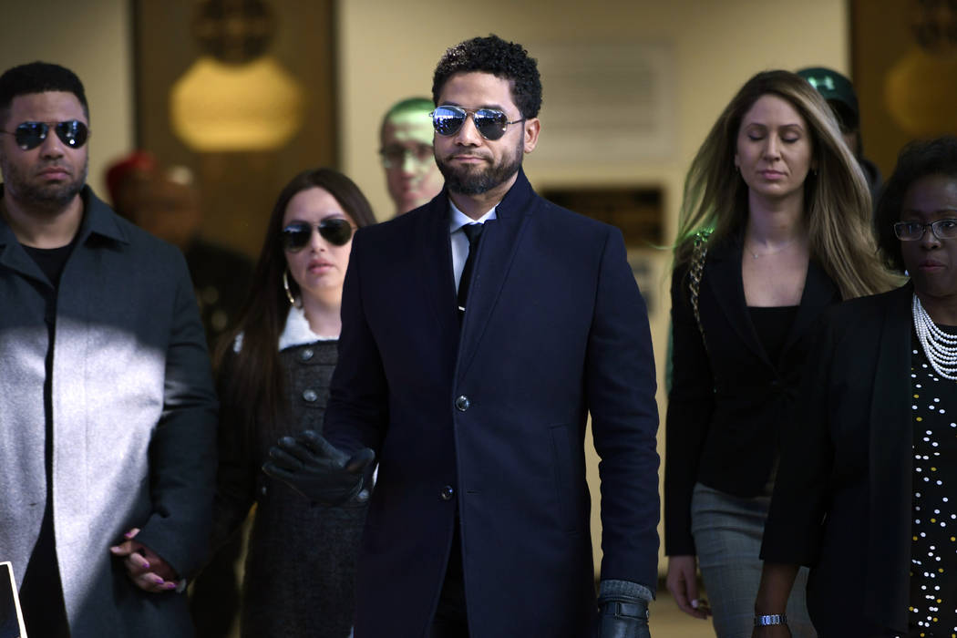 FILE - In this March 26, 2019 file photo, actor Jussie Smollett gestures as he leaves Cook Coun ...