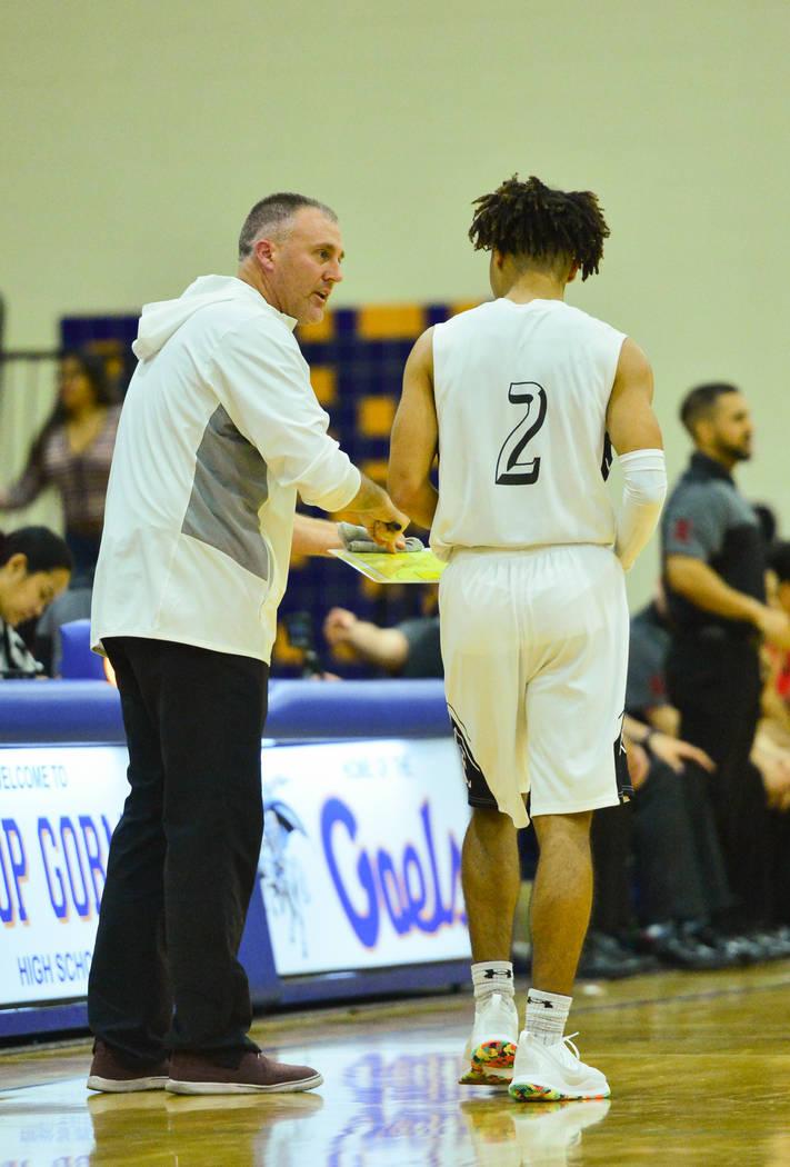 Faith Lutheran head coach Bret Walter talks to Donavan Jackson (2) during a game between Libert ...