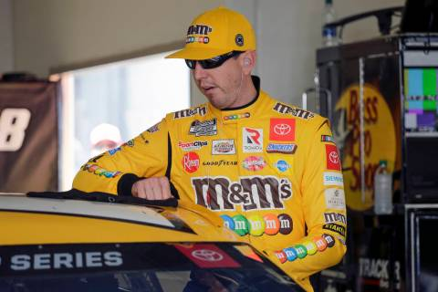 Kyle Busch prepares to get in his car during NASCAR auto race practice at Daytona International ...