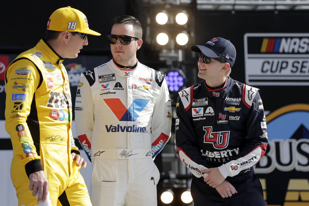 Kyle Busch, left, Alex Bowman, center, and William Byron talk during introductions before the N ...