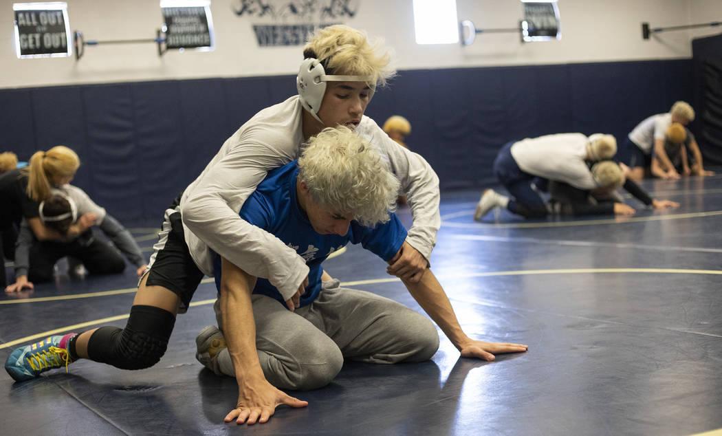 Sophomore Trent Smith, top, wrestles senior Triston Curtis, bottom, during wrestling practice a ...