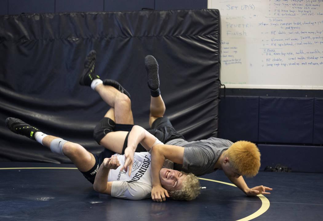 Senior Noah Gallardo, left, practices with his teammate, senior Joel Hemintakoon, during wrestl ...