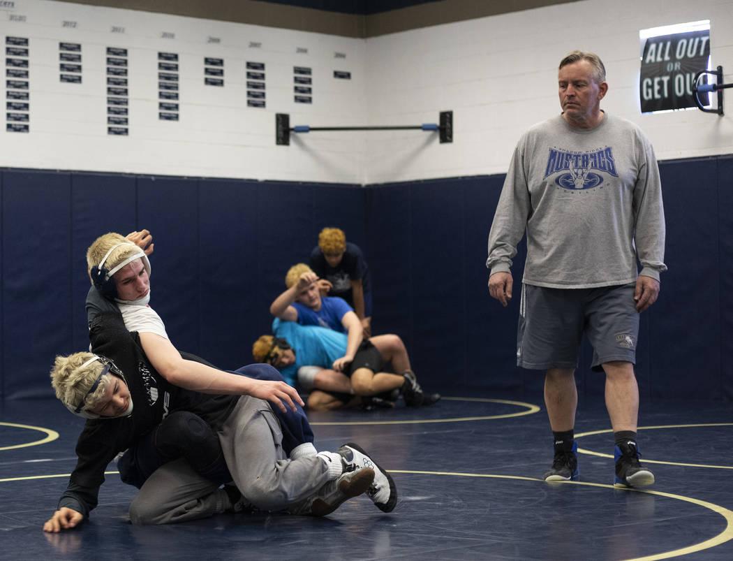 Senior Weston Presser, top, wrestles against senior Matt Van Riel, bottom, during the last prac ...