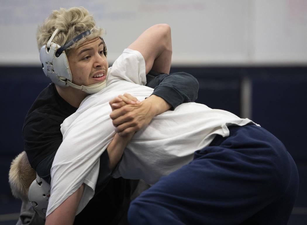 Senior Matt Van Riel, top, wrestles against senior Weston Presser, bottom, during the last prac ...