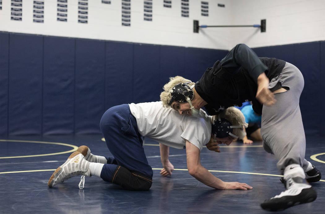 Senior Matt Van Riel, right, wrestles against senior Weston Presser, left, during the last prac ...