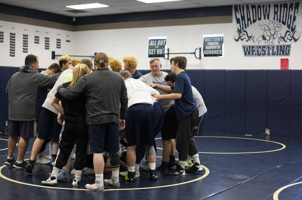 The Shadow Ridge High School wrestling team does a final chant after practice at Shadow Ridge H ...