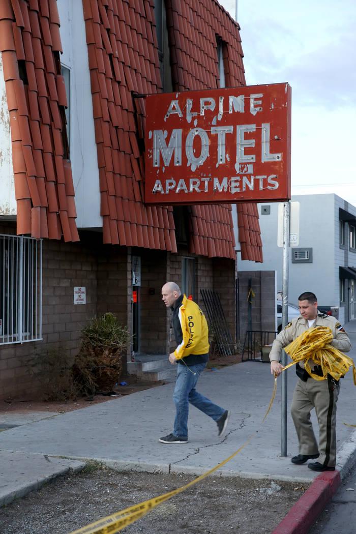 Las Vegas police remove crime scene tape at the Alpine Motel Apartments Wednesday, Dec. 25, 201 ...