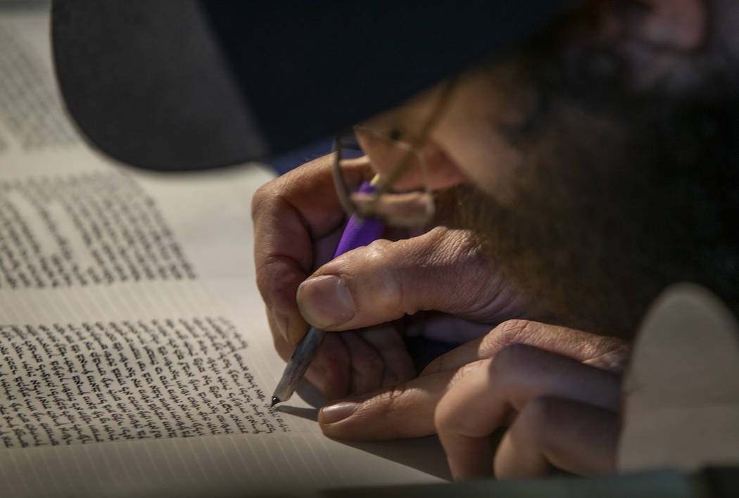 Rabbi Dovid Bressman as Sofer inscribe s the last few words on the new Torah during a ceremony ...