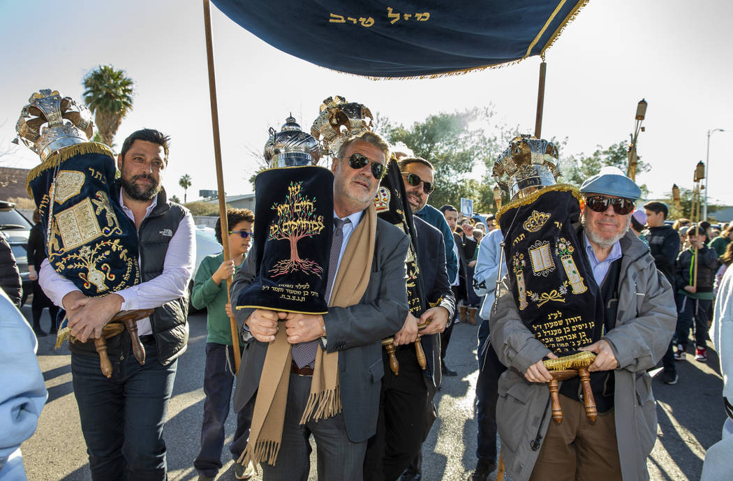 Chabad of Southern Nevada members join their new Torah with the three existing ones into to the ...