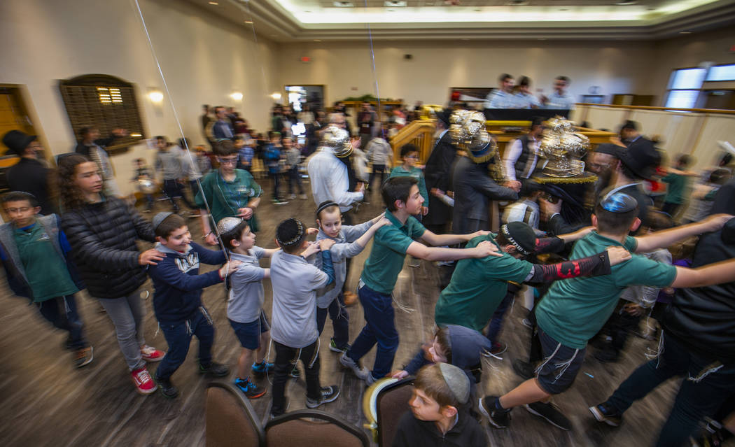 Chabad of Southern Nevada members dance with their new Torah and the three existing ones about ...