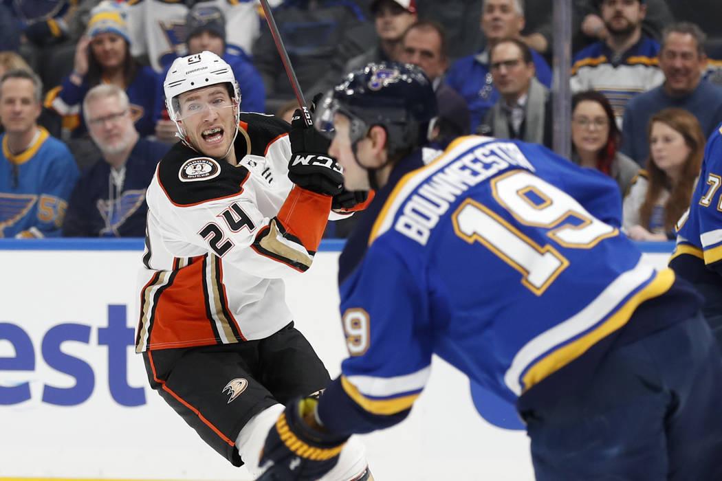 St. Louis Blues' Jay Bouwmeester (19) handles the puck as Anaheim Ducks' Carter Rowney (24) def ...