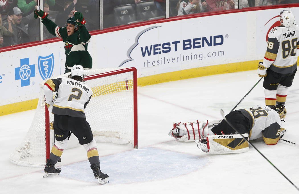 Minnesota Wild's Joel Eriksson Ek, top left, celebrates his power play goal off Vegas Golden Kn ...