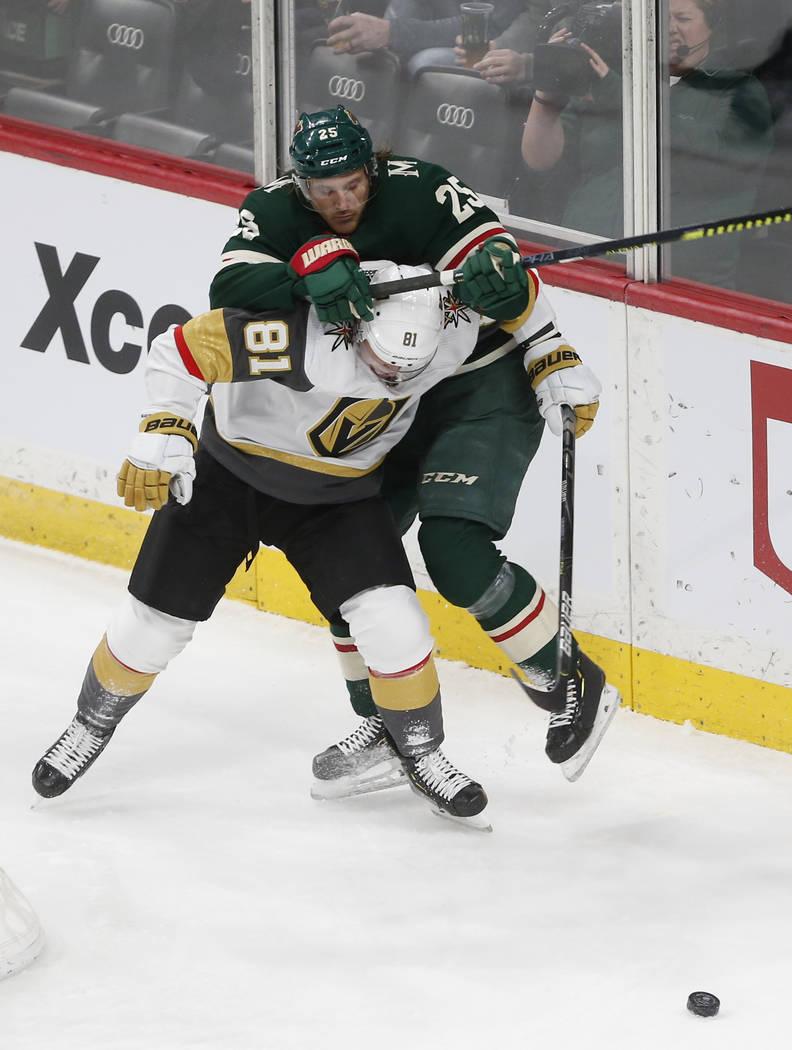 Minnesota Wild's Jonas Brodin, top, and Vegas Golden Knights' Jonathan Marchessault battle for ...