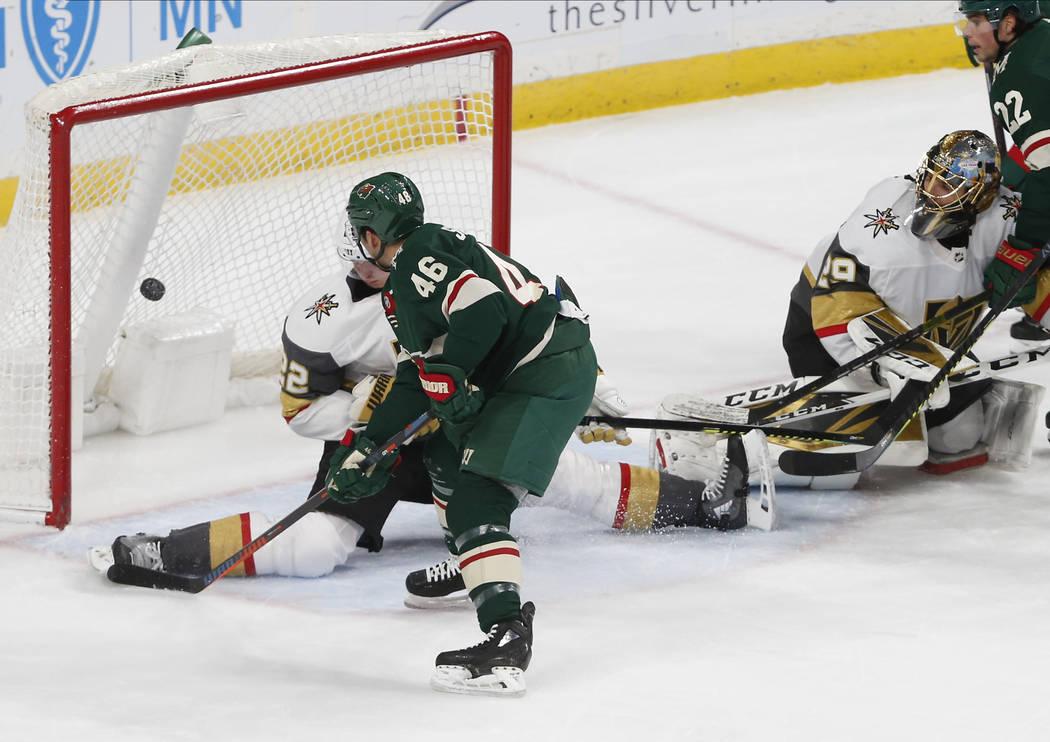 Minnesota Wild's Jared Spurgeon, left, scores a power play goal against Vegas Golden Knights' g ...