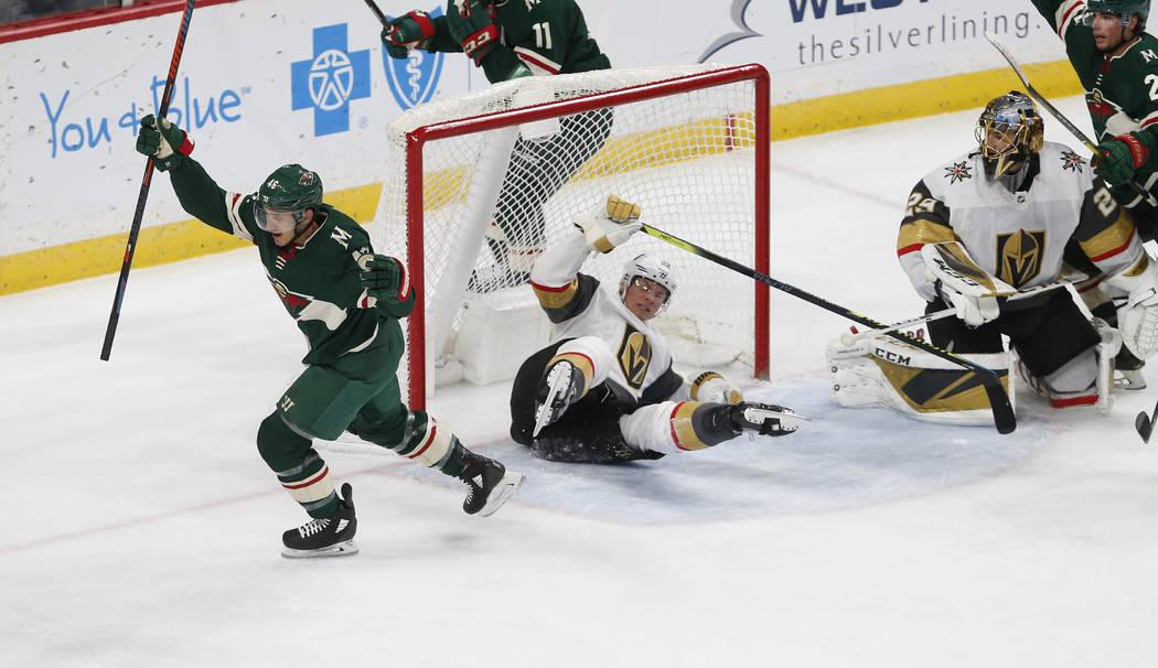 Minnesota Wild's Jared Spurgeon, left, celebrates his power play goal off Vegas Golden Knights' ...