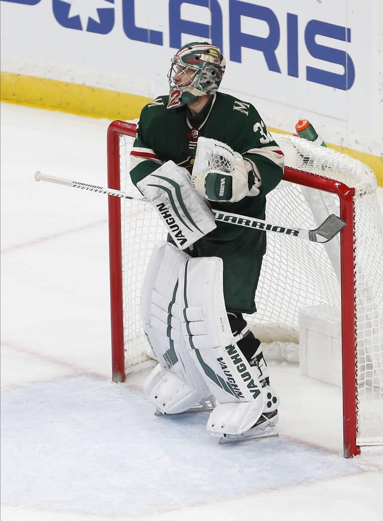 Minnesota Wild's Alex Stalock hits his hockey stick against the post as he celebrates his 4-0 s ...