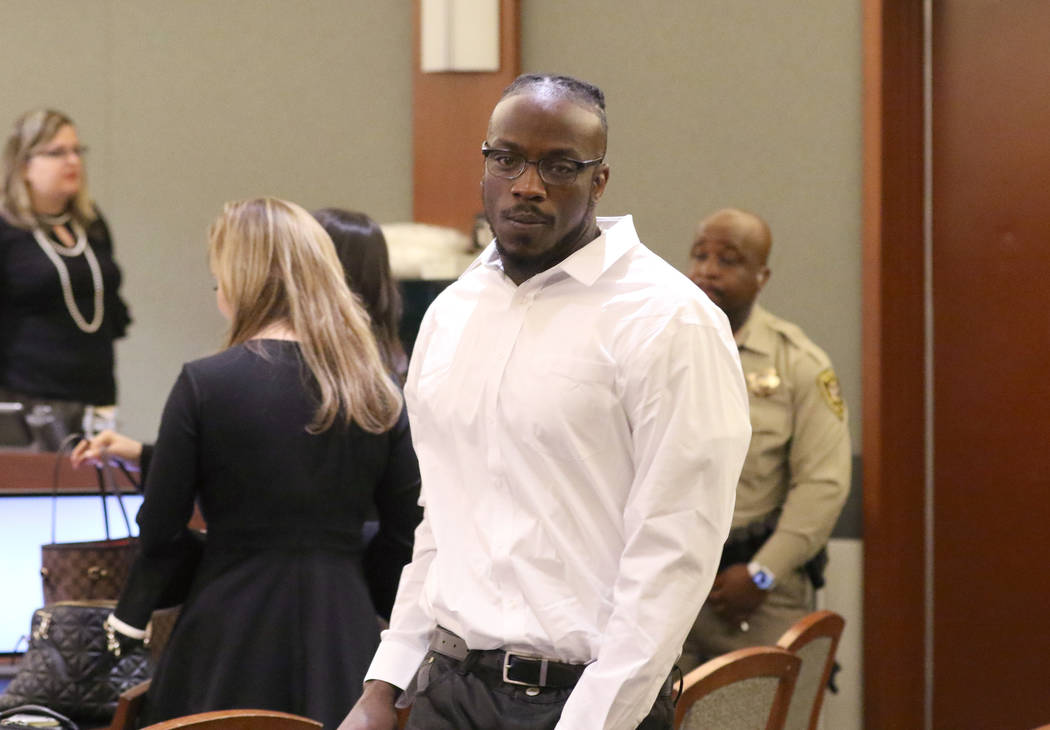 Durwin Allen, charged in the killings of Myron Manghum, 33, and Alyssa Velasco, 27, leaves the ...