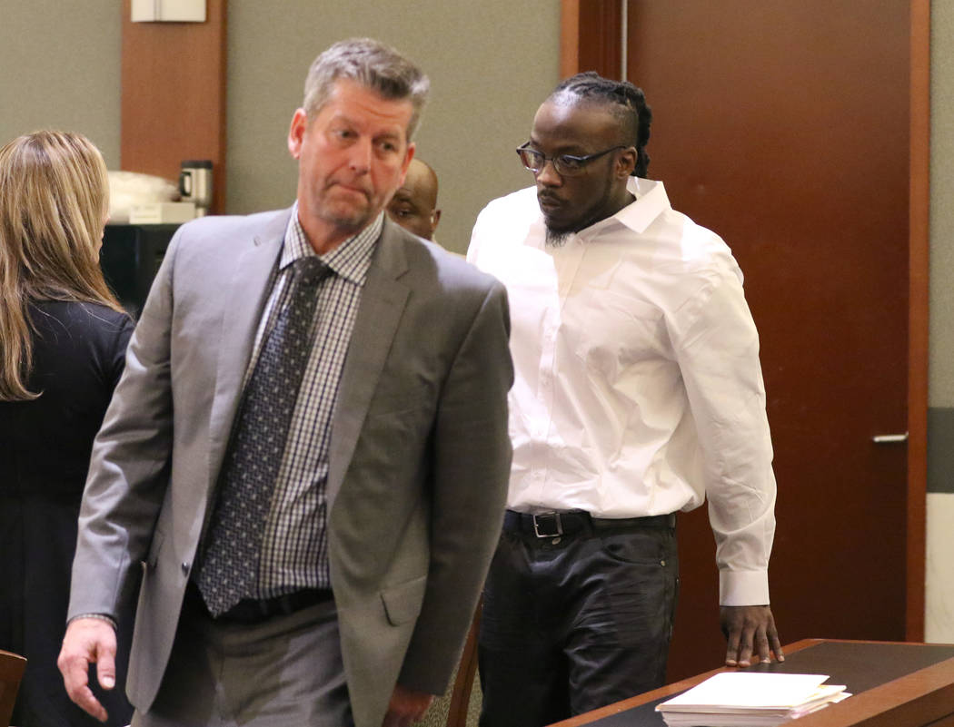 Durwin Allen, right, charged in the killings of Myron Manghum, 33, and Alyssa Velasco, 27, leav ...