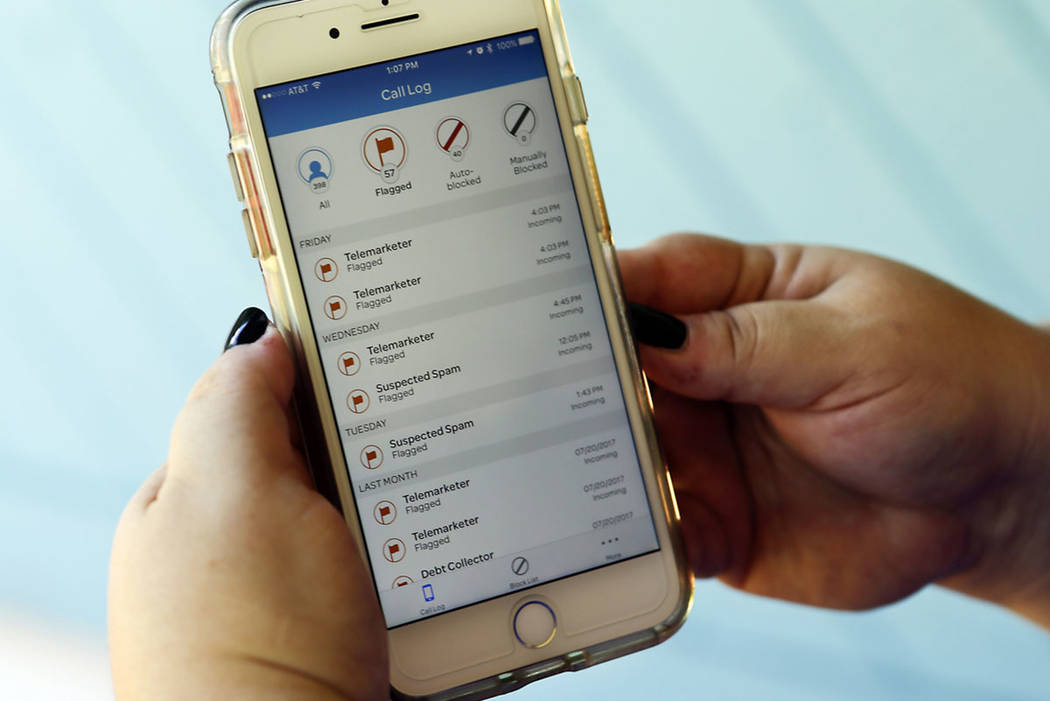 A call log is displayed via an AT&T app on a cellphone in Orlando, Fla. (AP Photo/John Raoux)