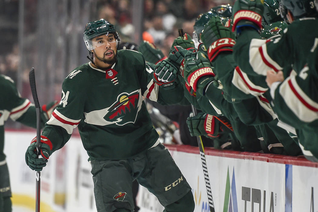 Minnesota Wild defenseman Mathew Dumba celebrates with the bench after scoring a goal against t ...