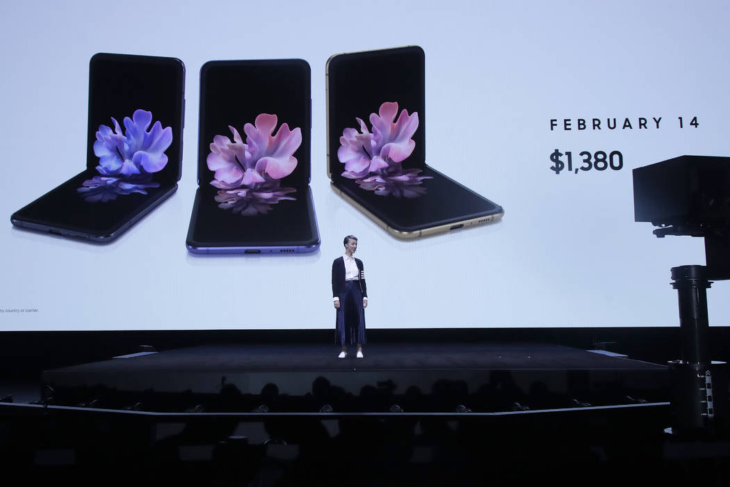 Rebecca Hirst, head of UK Mobile Product Development, speaks in front of photos of Samsung Gala ...