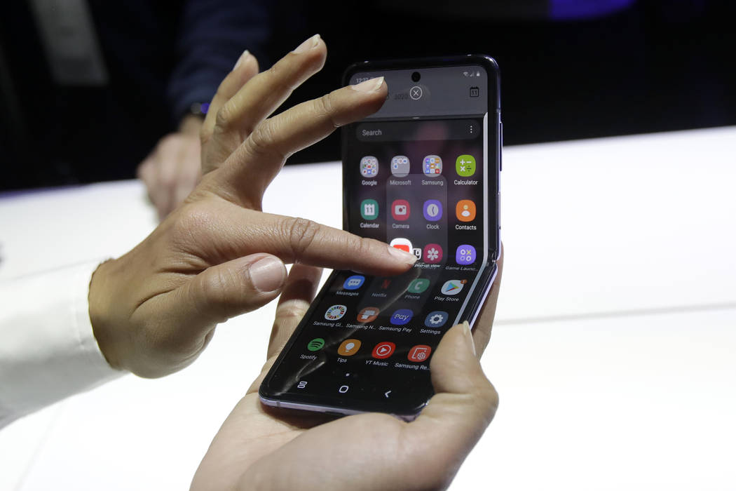 A Samsung worker gives a demonstration of the Galaxy Z Flip Phone at the Unpacked 2020 event in ...
