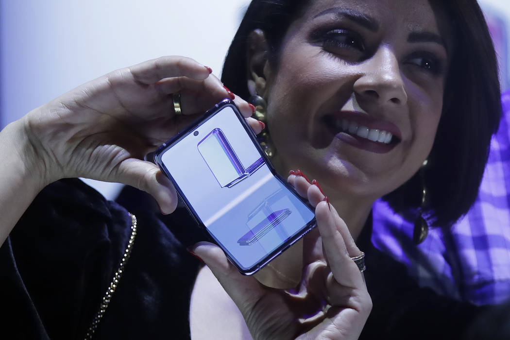 A woman holds a Samsung Galaxy Z Flip Phone displayed at the Unpacked 2020 event in San Francis ...