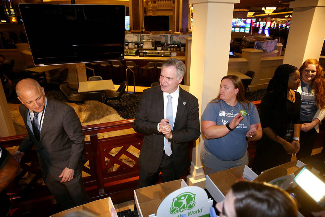 Raiders president Marc Badain, from left, Jim Murren, MGM Resorts CEO and chairman, and Sheree ...