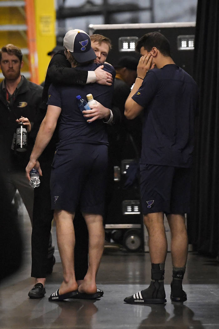 Anaheim Ducks left wing Max Jones, second from right, greets two members of the St. Louis Blues ...