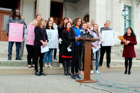 Danbury High School sophomore Alanna Smith speaks during a news conference at the Connecticut S ...