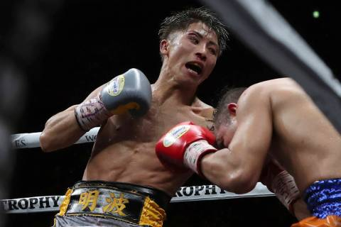 Japan's Naoya Inoue, left, sends a left to Philippines' Nonito Donaire in the 11th round of the ...