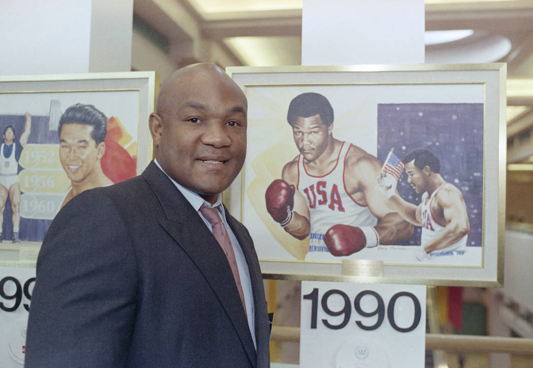 Boxer George Foreman posed by a painting of himself when he was at Olympic in 1988, prior to hi ...