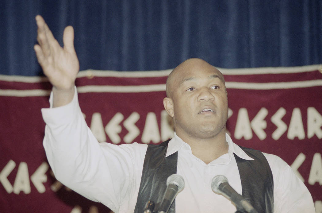 Former world heavyweight champion George Foreman gestures as he speaks at news conference in Lo ...