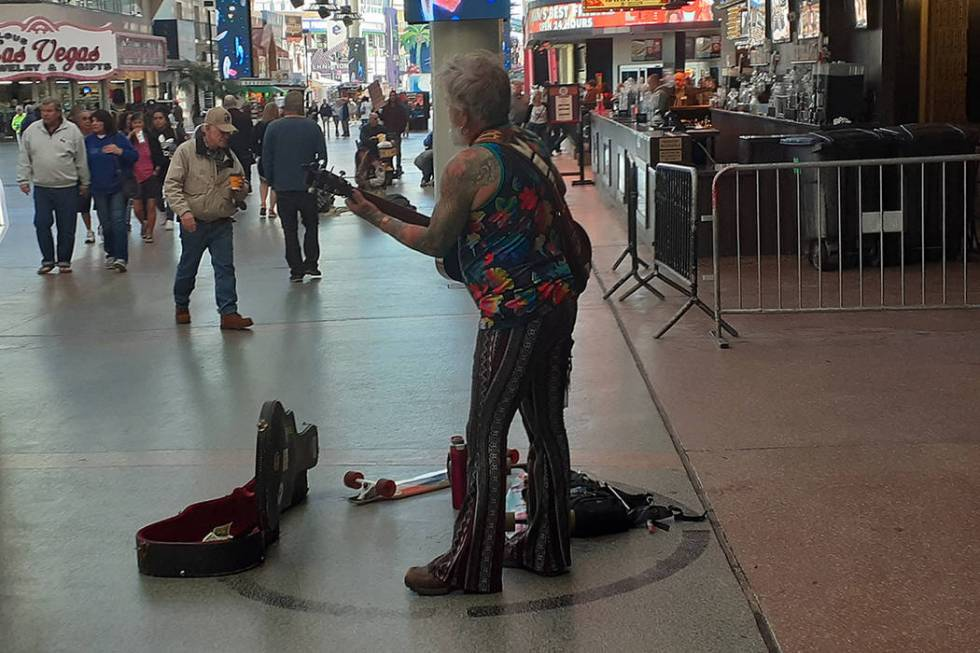 A guitar player performs Wednesday, Feb. 12, 2020, on the Fremont Street Experience in Las Vega ...