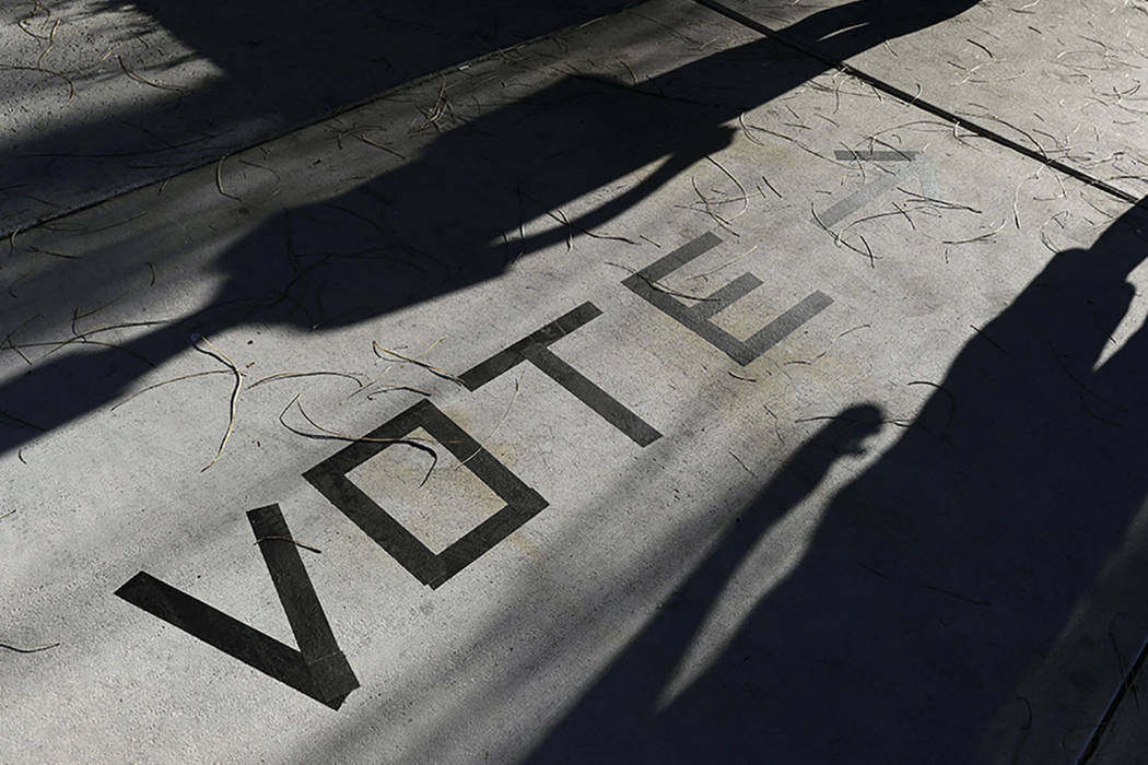 Voters head to the polls at the Enterprise Library in Las Vegas in November 2018. (AP Photo/Joe ...