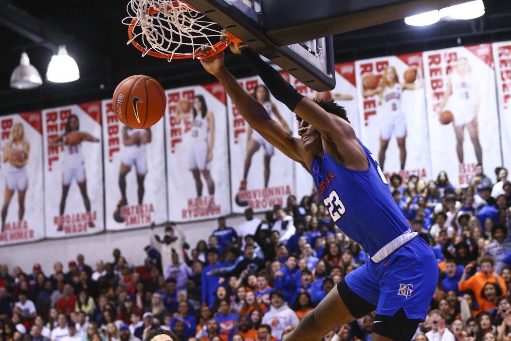 Bishop Gorman's Mwani Wilkinson (23) dunks off an alley-oop during the second half of a basketb ...