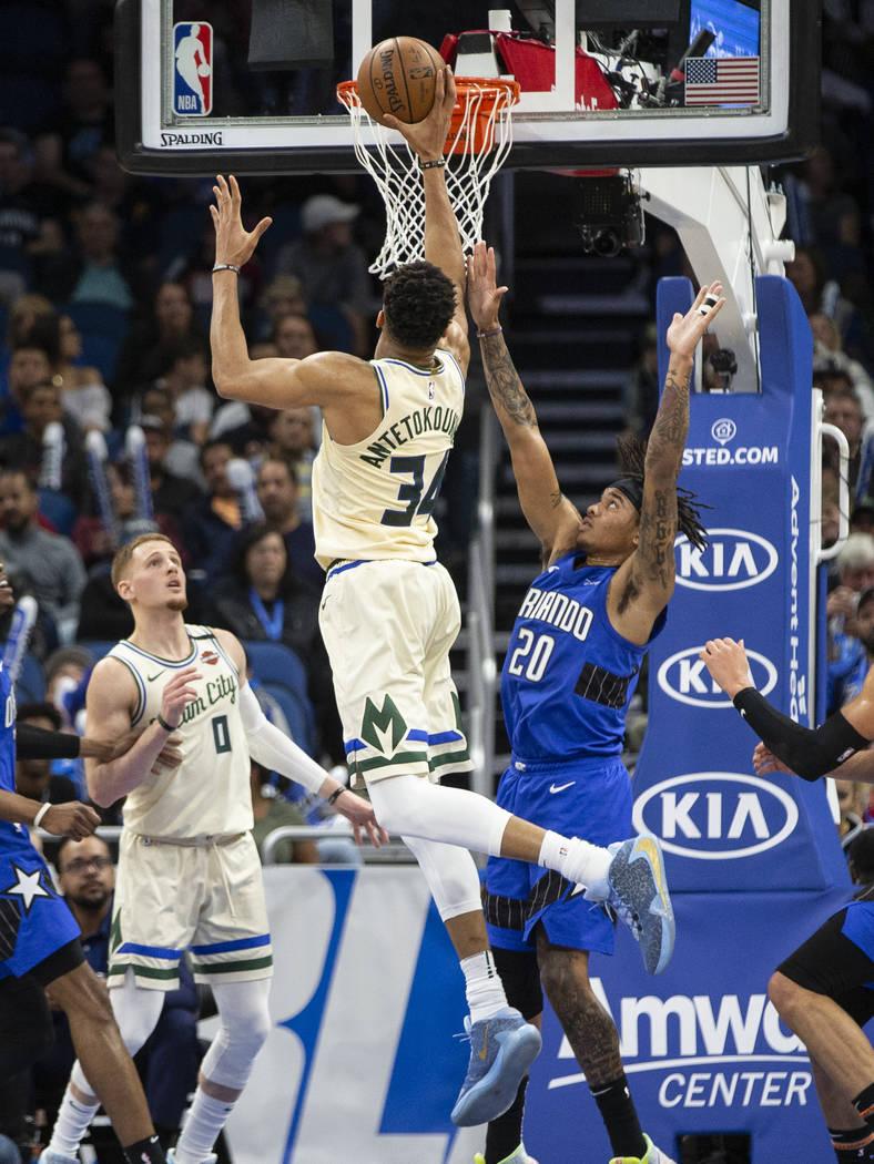 Milwaukee Bucks forward Giannis Antetokounmpo (34) shoots over Orlando Magic guard Markelle Ful ...