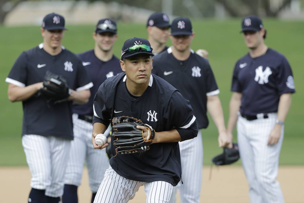 New York Yankees' Masahiro Tanaka, of Japan,during a spring training baseball workout Thursday, ...
