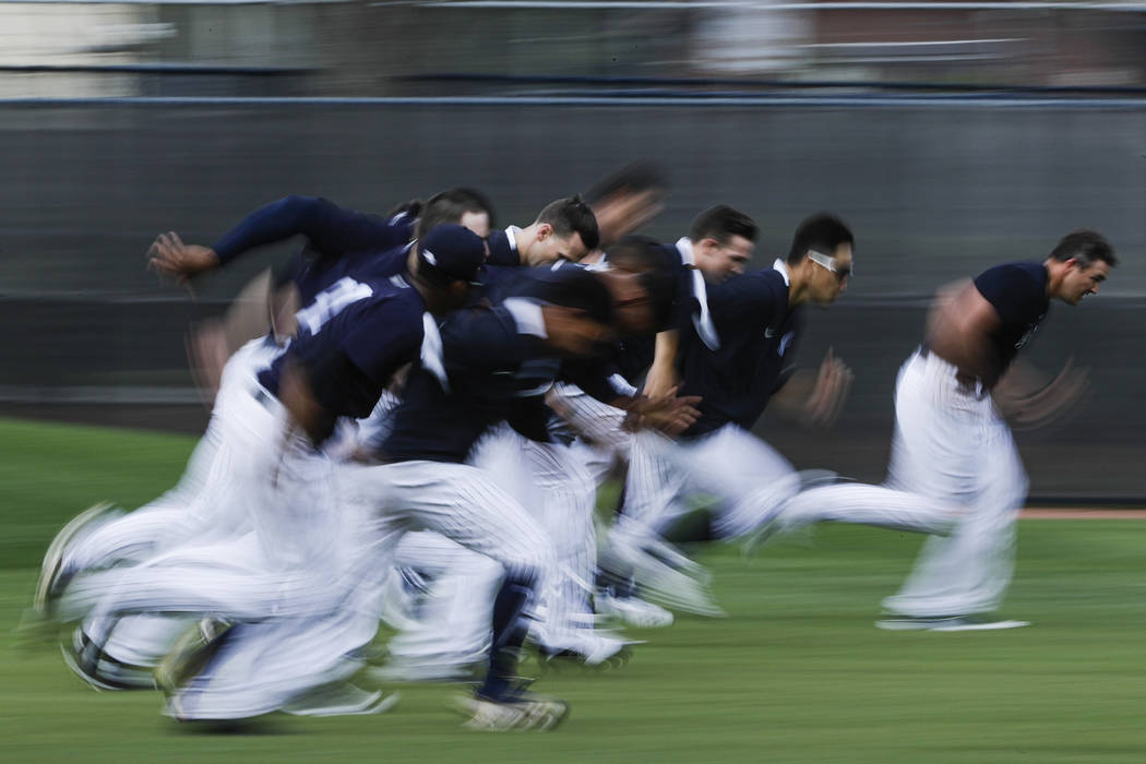New York Yankees pitchers run during a spring training baseball workout Thursday, Feb. 13, 2020 ...