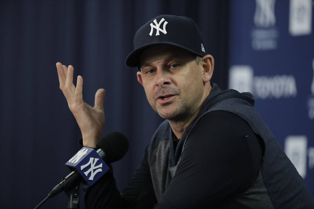 New York Yankees manager Aaron Boone speaks during a news conference after spring training base ...