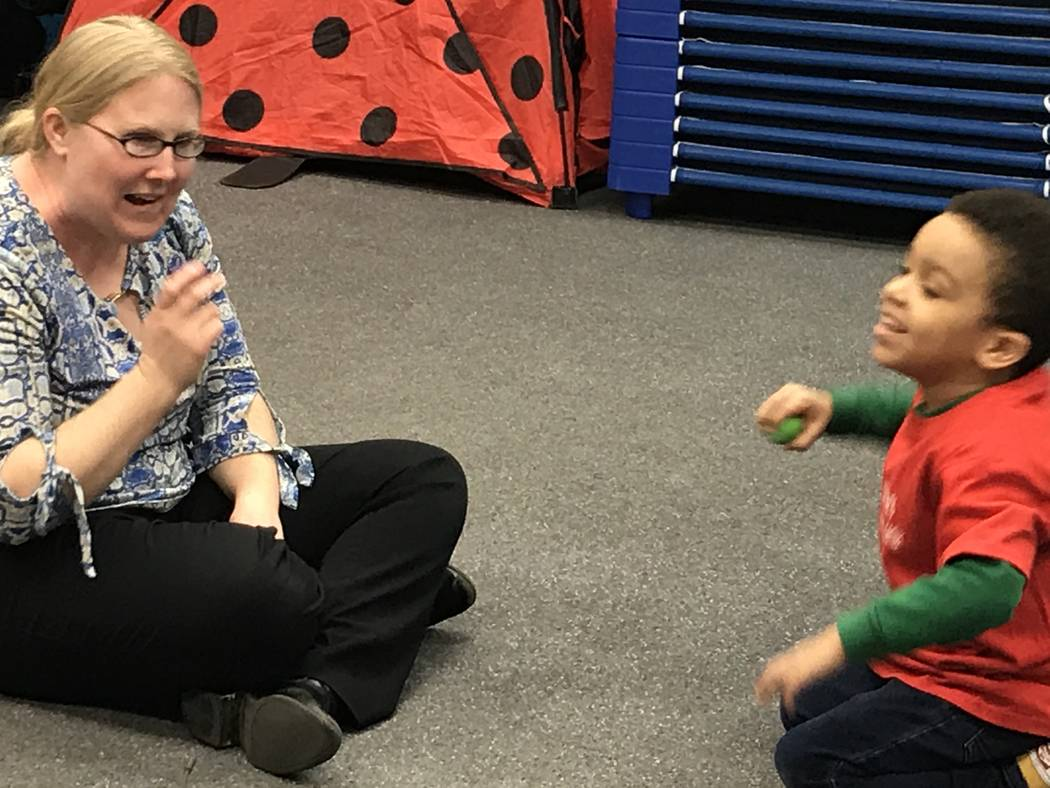 Emily Rawlings with Dynamic Music Therapy leads preschoolers during a music therapy session as ...