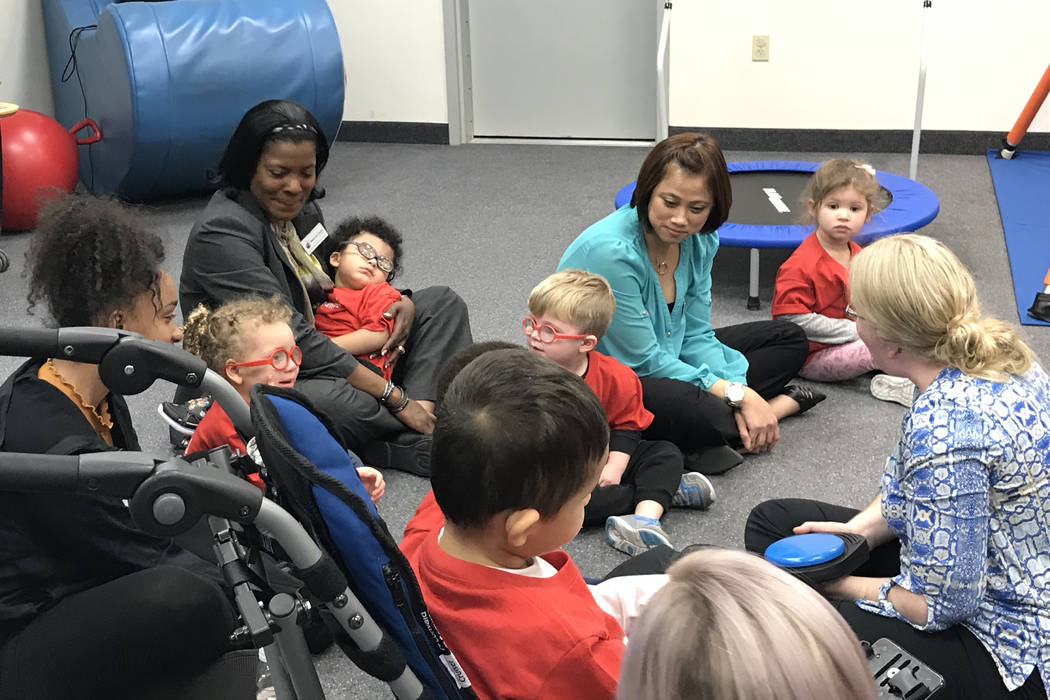 Preschoolers, their parents and employees participate in a music therapy session Feb. 12 at the ...