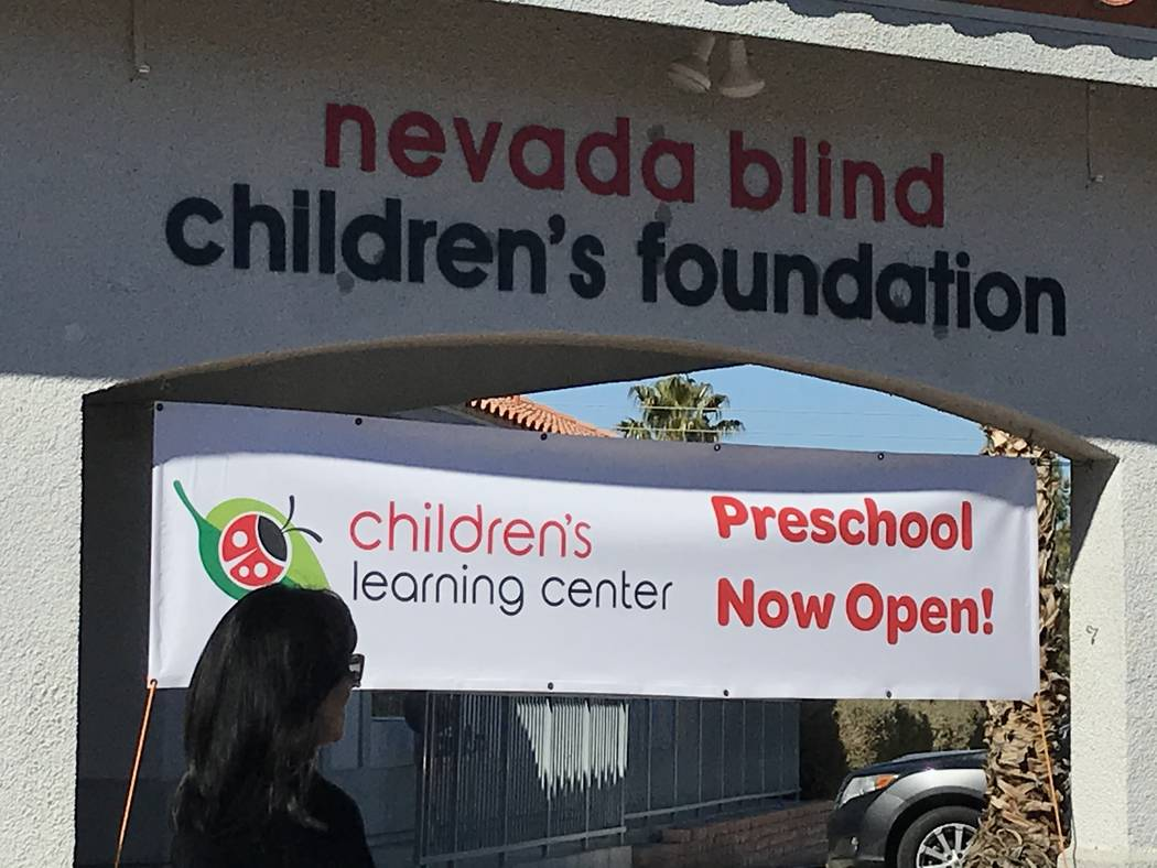 A ribbon cutting ceremony attendee walks Feb. 12 in front of the Nevada Blind Children's Foun ...