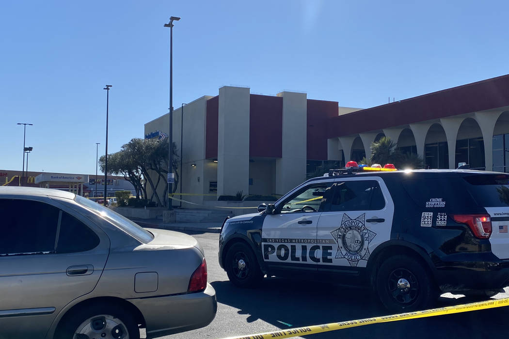 Las Vegas police investigate a shooting Thursday afternoon in southeast Las Vegas near the UNLV ...