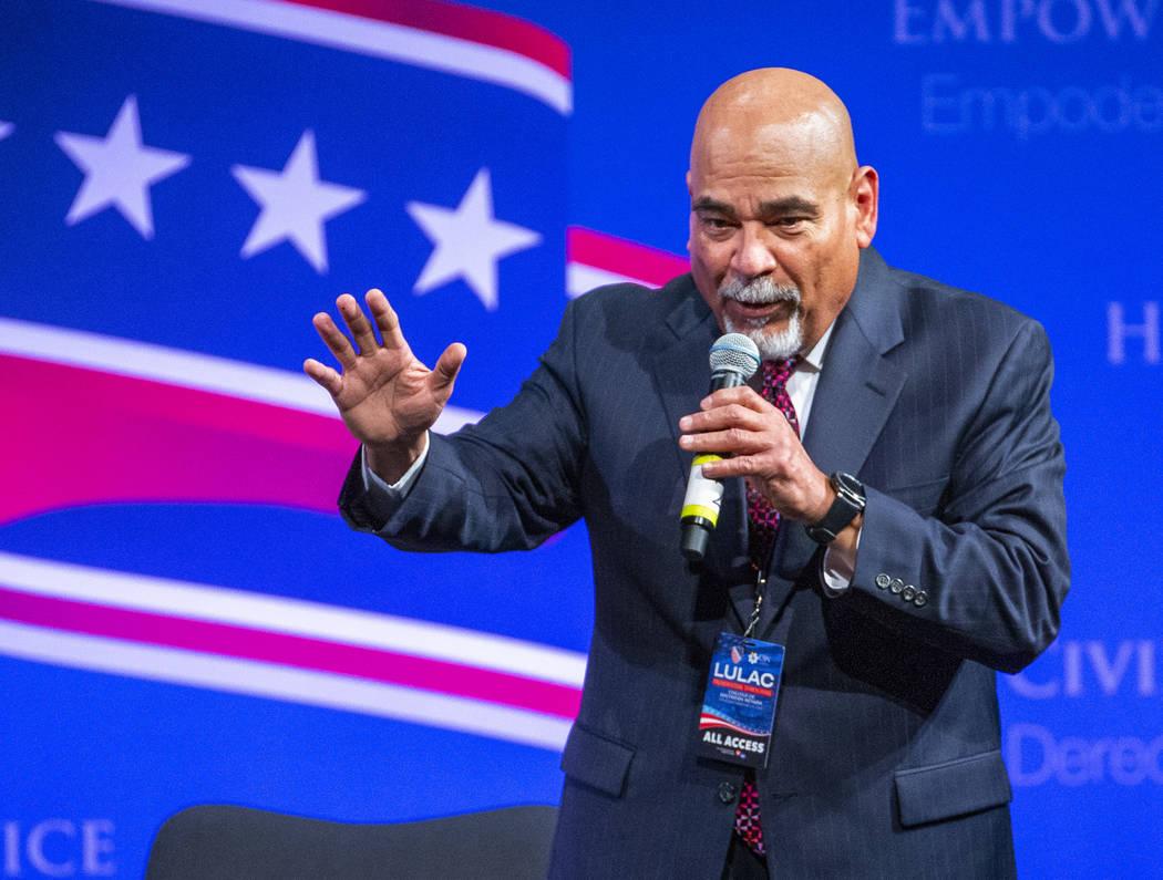 Communications director David Cruz for the League of United Latin American Citizens speaks duri ...