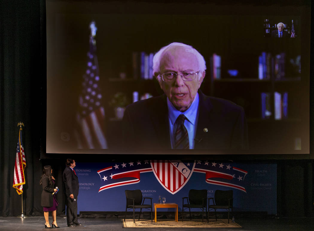 Sen. Bernie Sanders, I-Vt., above, fields questions from Leticia Castro and Domingo Garcia of t ...