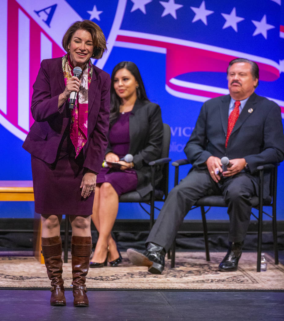 Sen. Amy Klobuchar, D-Minn., left, answers questions in front of Leticia Castro and Domingo Gar ...