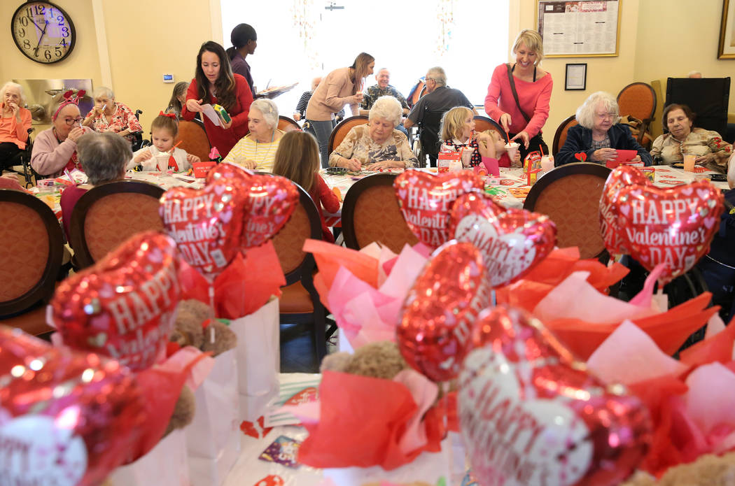 Preschoolers, toddlers and their moms celebrated Valentine's Day with the senior residents at P ...