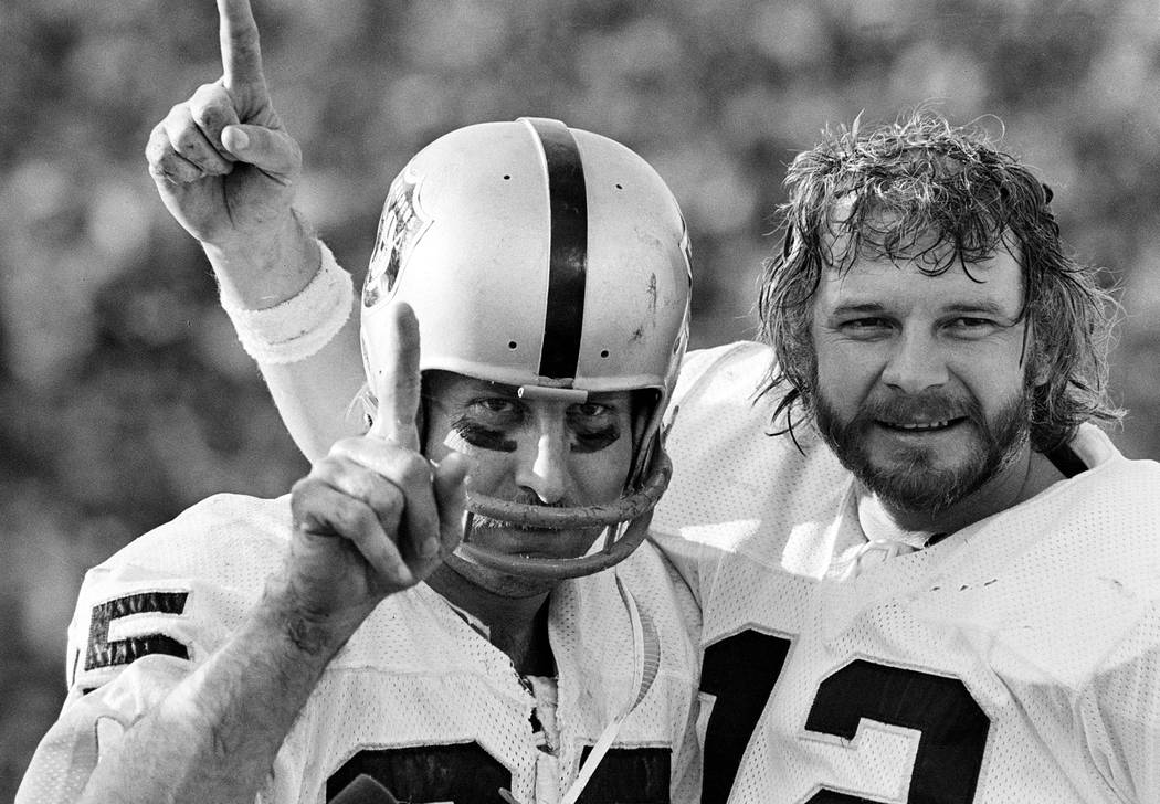 FILE - In this Jan. 9, 1977, file photo, receiver Fred Biletnikoff, left, and quarterback Ken S ...