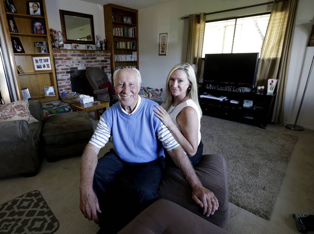 FILE - In this July 23, 2015 file photo, NFL Hall of Famer Fred Biletnikoff and his wife, Angel ...
